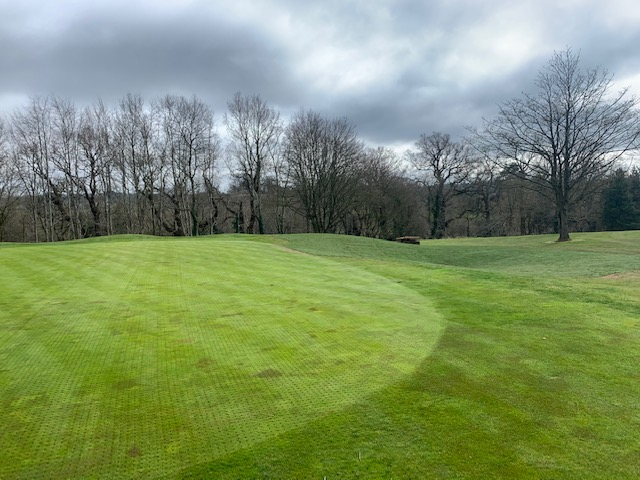 'After' photo with greenside bunker converted to grassy hollow
